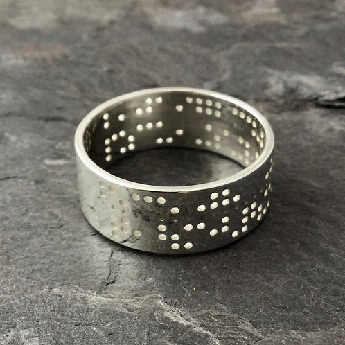 Punched tape decoder ring makes unique wedding band