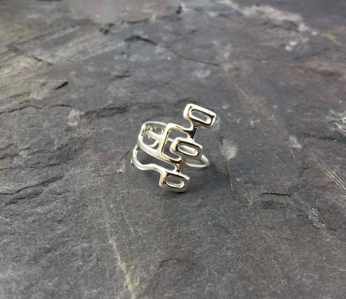 The final ring after it was 3D printed in wax and cast in silver by Shapeways!