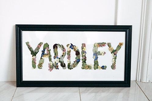 Custom pressed name frame