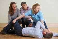 Woman Demonstrating Recovery Position In