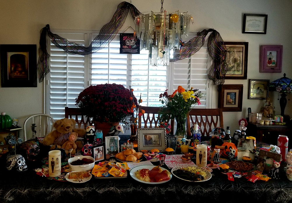 This shows our family altar with their favorite foods and photos to commemorate and celebrate
