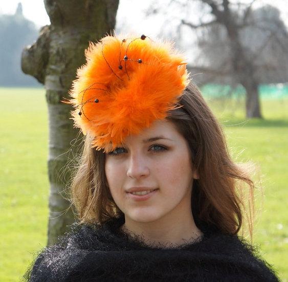 Orange feather fascinator