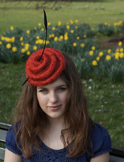 Red swirl cocktail hat