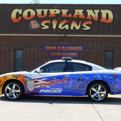 Airbrush art on DARE car infront of Coupland Signs.