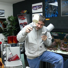 In studio, posing for a painting.