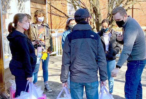 Volunteers distributing facemasks