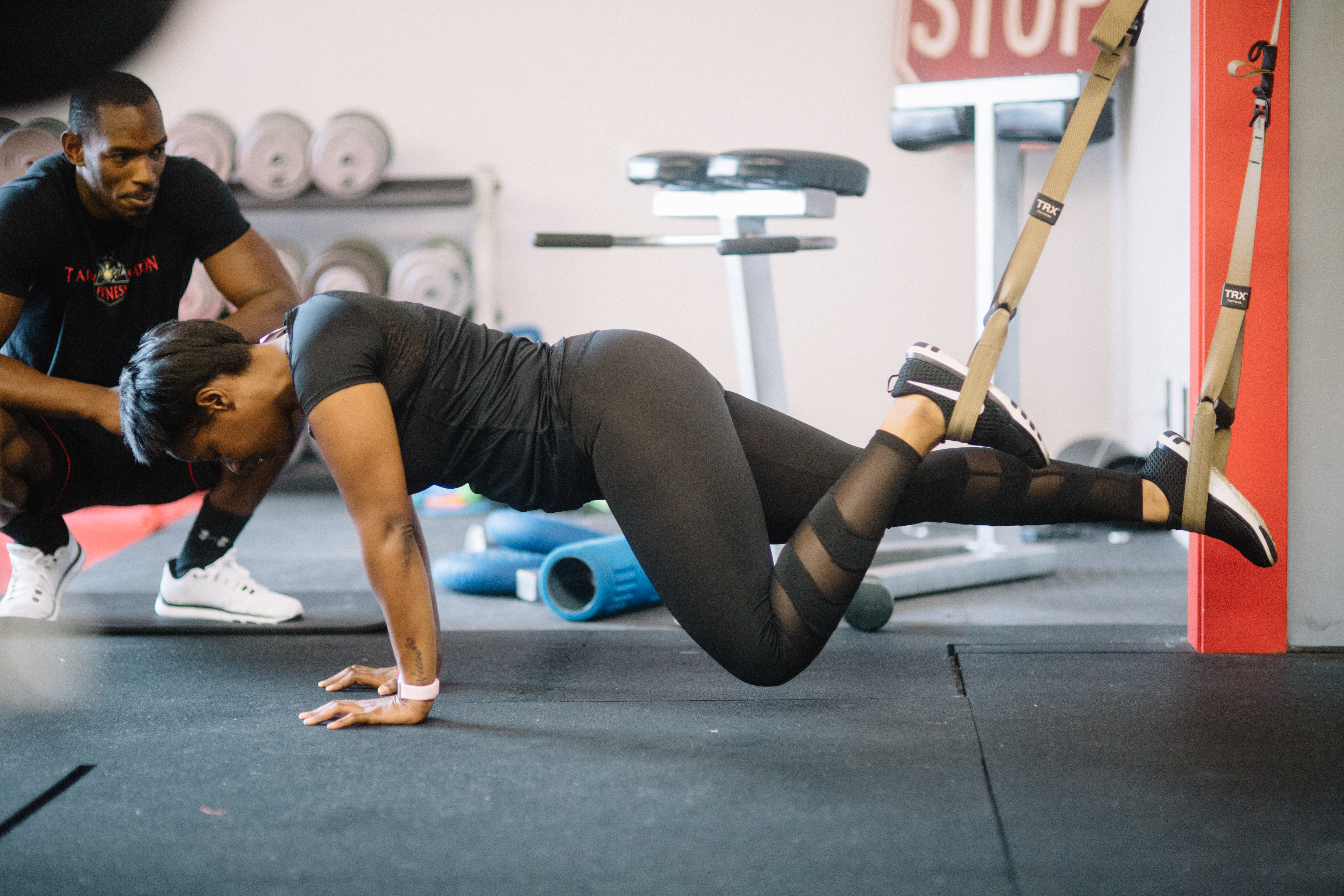 Woman in TRX cables doing an exercise