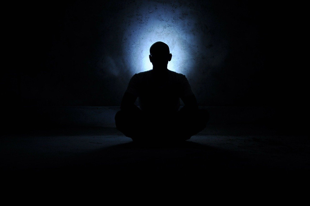 man meditating finding the kingdom of heaven within