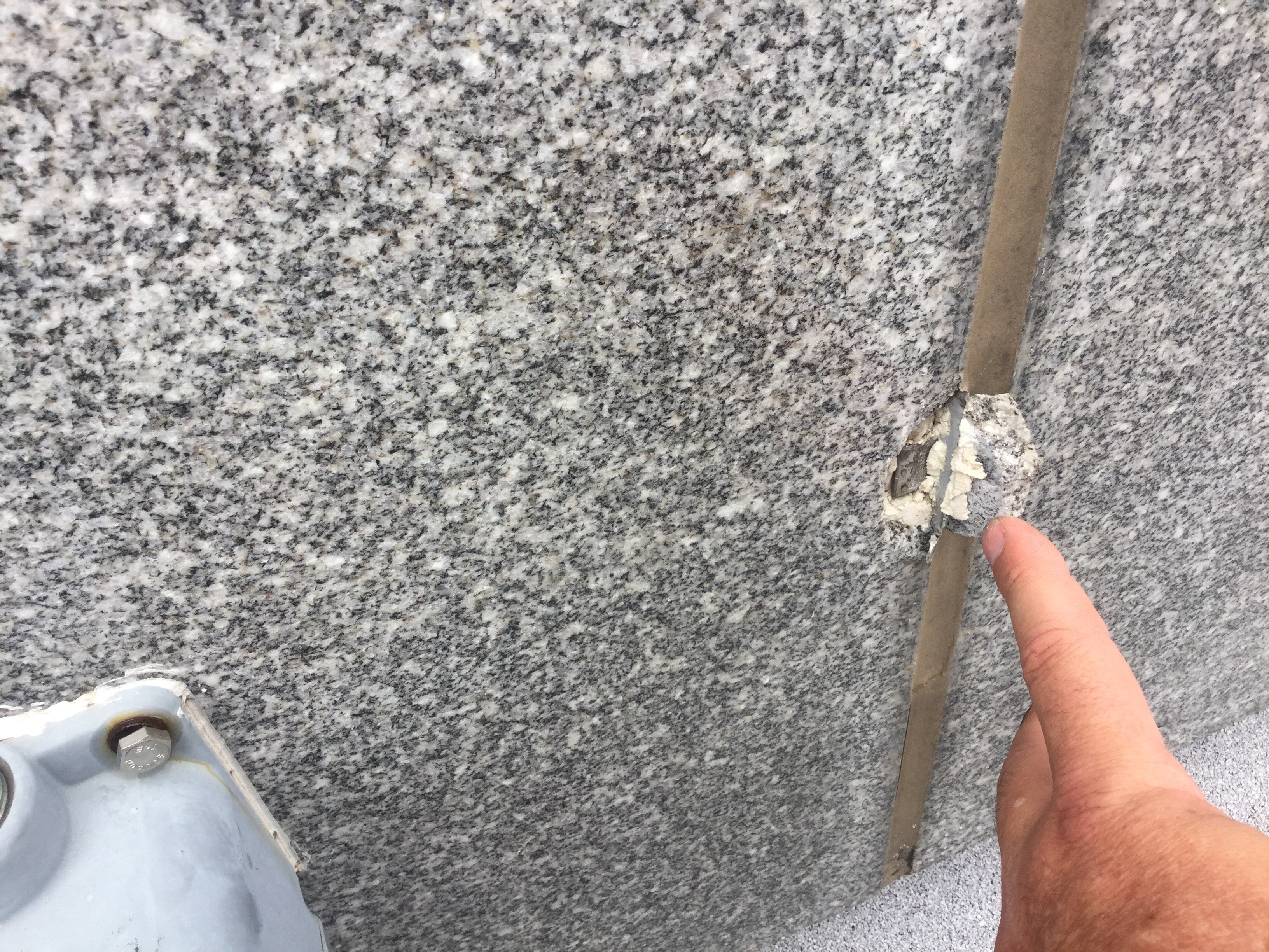 Granite damage at wind anchor