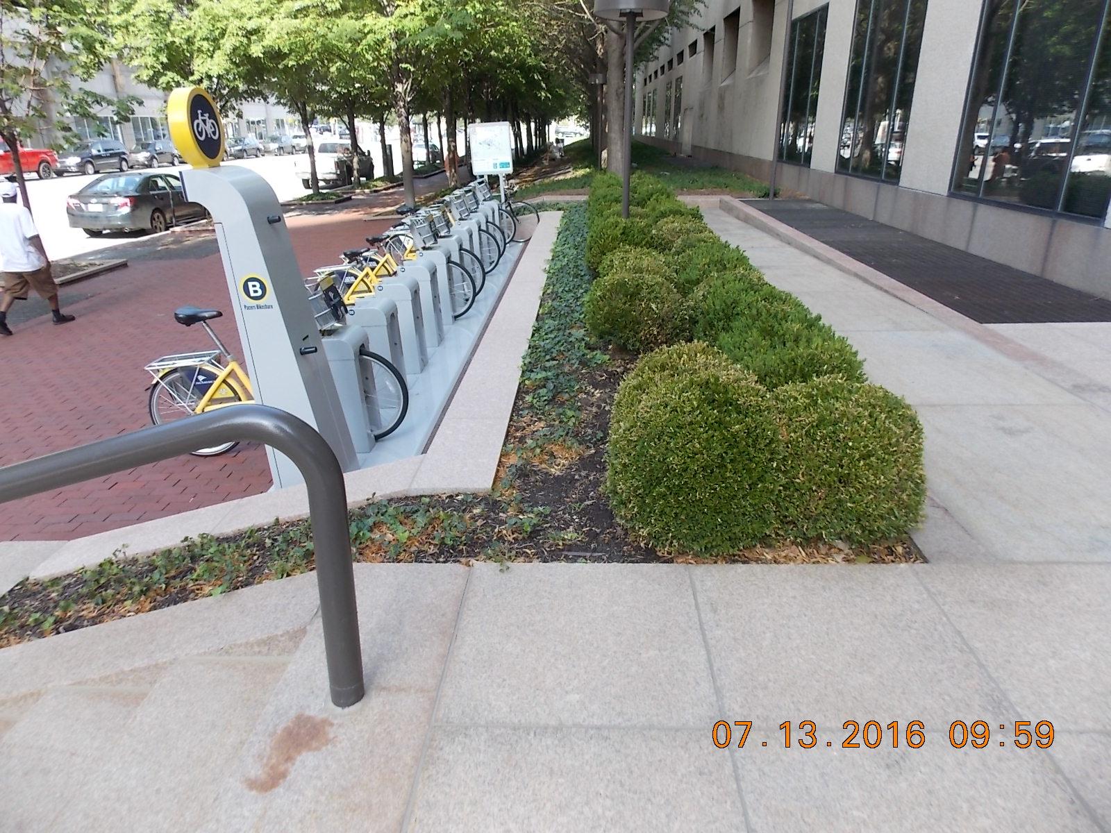 Reconfigured sidewalk in completion