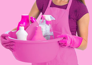 A woman wearing gloves holds a bucket of cleaning supplies. Residential cleaning includes housekeeping, high-level dusting, maintenance cleaning, deep cleaning, and more.