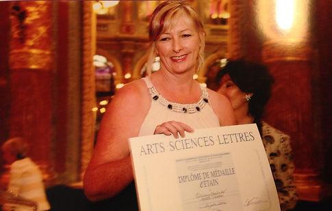 Olivia receiving her diploma award in Paris
