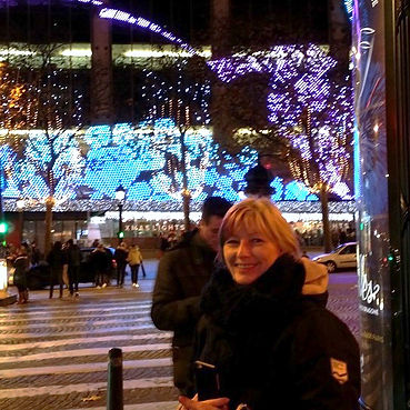 Olivia on the Champs Elysees after her Paris exhibition