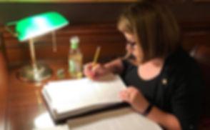 Senator Karla Bigham reading legislation