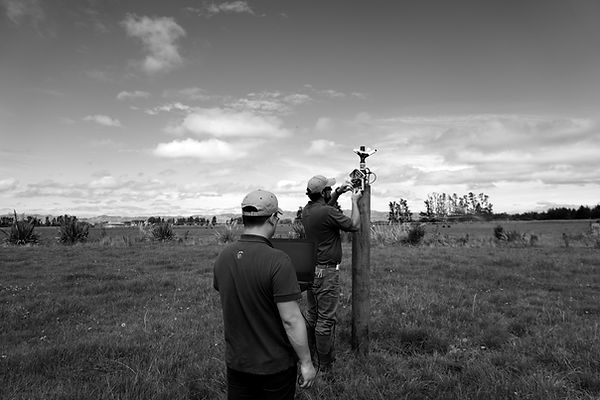 Onfarm Data technical and engineering staff working on a fixed grid control system in New Zealand
