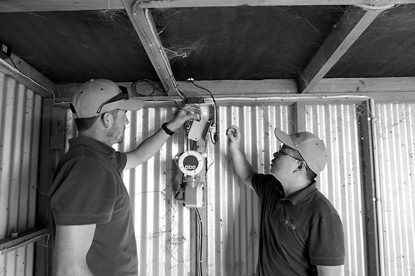 Onfarm Data's staff doing maintenance work on the pivot control system