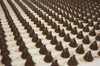 Sweets on a chocolate factory conveyor.j