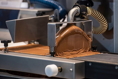 Industrial machine to cover with sweet c