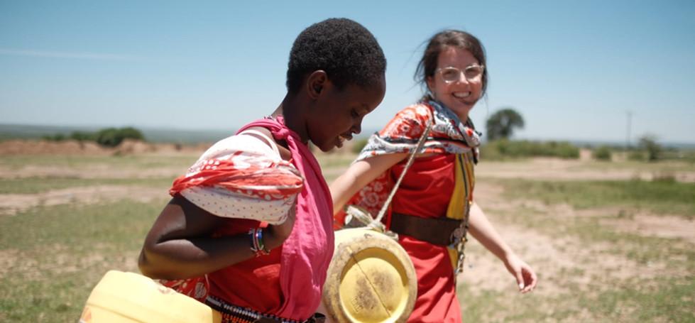 Fetching water with local Maasai women