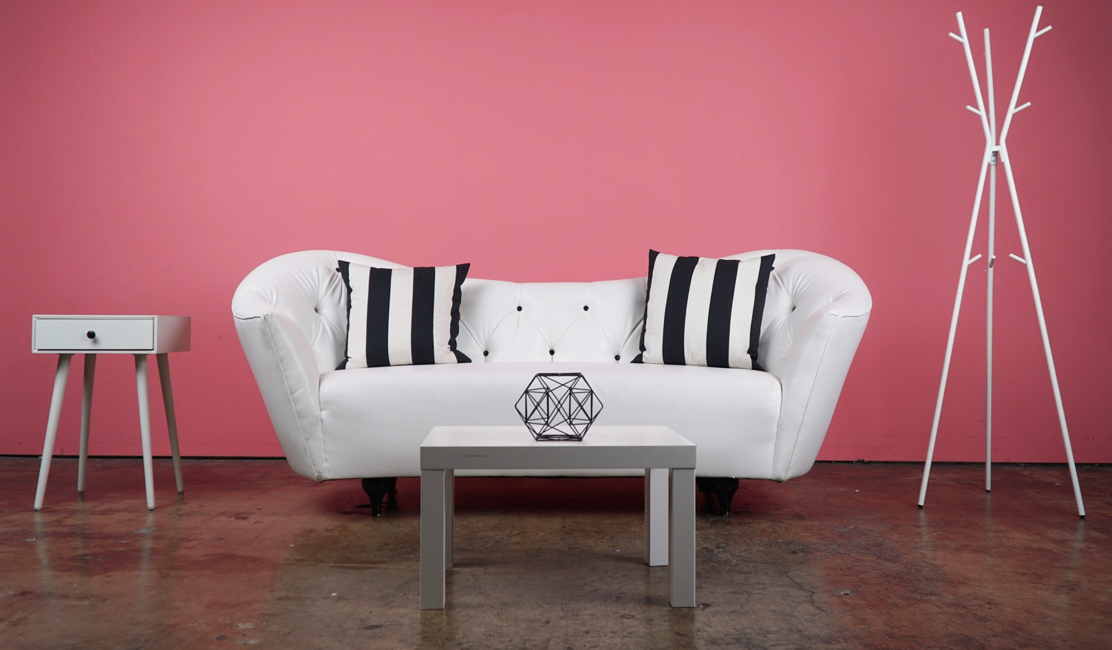 Pink Wall - White Sofa