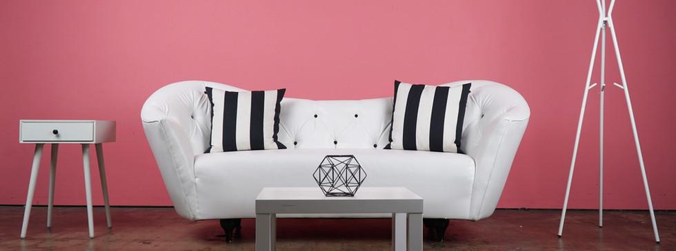 Pink Wall - White Sofa