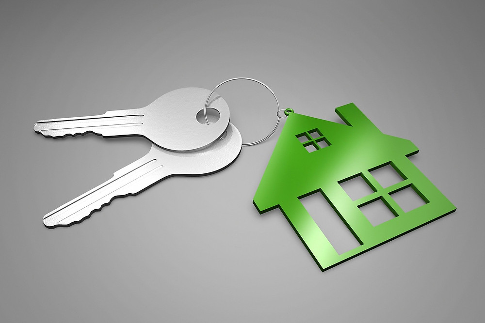 keys with house keychain attached