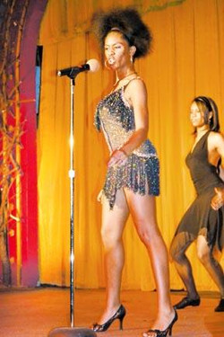 Sidney as Tina Turner