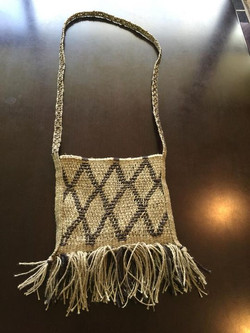 Twined bag in commercial hemp, lined with cotton, with a fingerwoven strap.