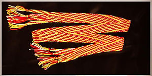 Red, white, and yellow acrylic yarn diagonal weave belt _60_ x 2___Sold_edited_edited.jpg