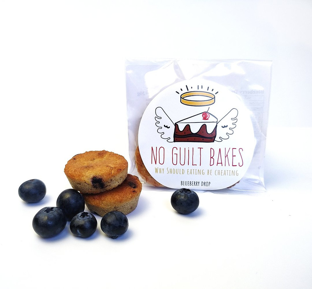 Blueberries surround two 'cake bites'. These are bite-sized cakes, cooked to a beautiful golden colour. The cakes are short but fluffy.