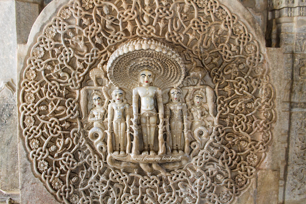 intricate temple carvings, intricate pillar carvings, gods carved in Stone, stone carvings of gods, Ranakpur jain temple, Udaipur day trip