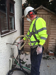 An image of a man installing cavity wall insulation.
