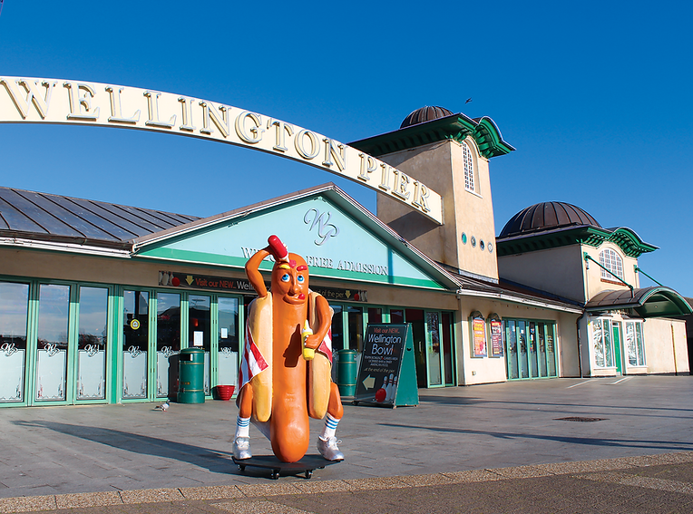6ft hot dog sculpture outside Wellington Pier