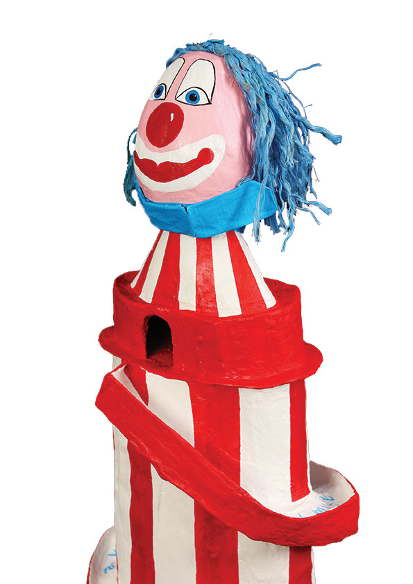 handpainted helter skelter sculpture  with large clown head as part of a collaborative project with a UEA writer