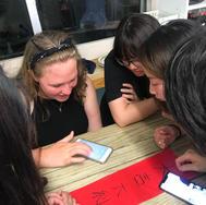 """Teaching a local how to write 'Fai Chun"""""""