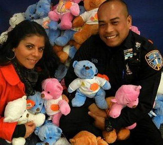 A Providence Police officer and Family Service of RI's Police Liaison Carla Cuellar.
