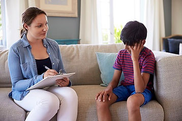 Photo representing a mental health counselor speaking with a boy