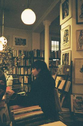 Hannah in a bookshop in Paris /2020