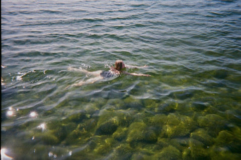 Valeria swimming in the Baltic Sea on a sunny day /2020