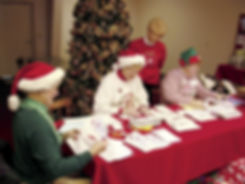 Pat Koch helping the Elves answer Letters to Santa