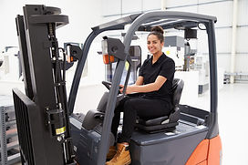 black woman working forklift .jpg