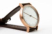design watch , brown leather strap ,one hand watch