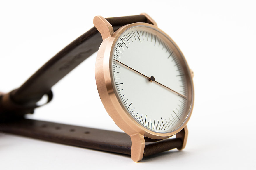design watch , brown leather strap ,one hand watch