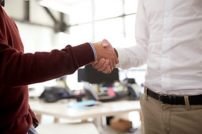 businessmen-making-handshake-at-office-P