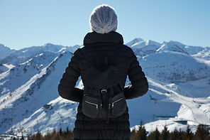 woman-looking-at-mountains-with-snow-in-