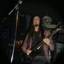 Lee C. Conley playing guitar