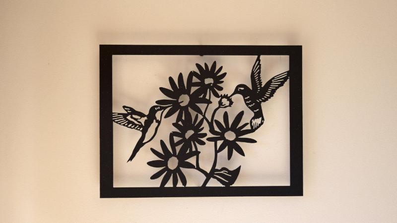 Hummingbirds and flowers wall hang.
