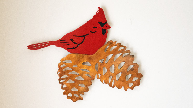 Cardinal and pine cones wall hang