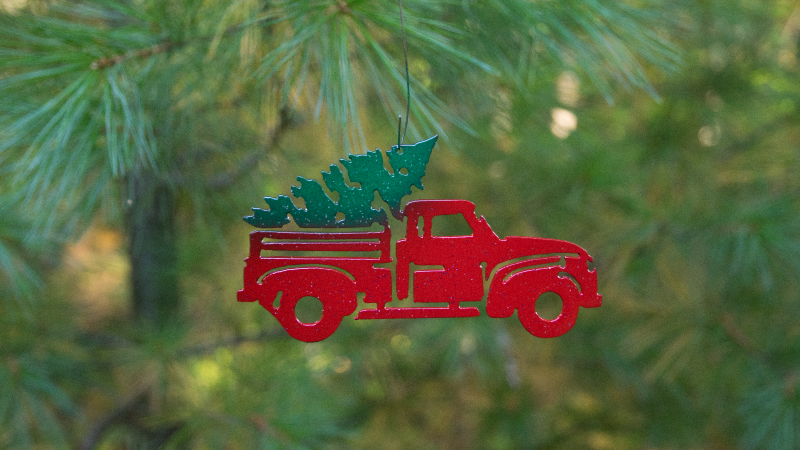 Truck with Christmas tree ornament