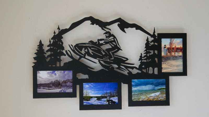 Snowmobiler 4 place picture frame w/mountain